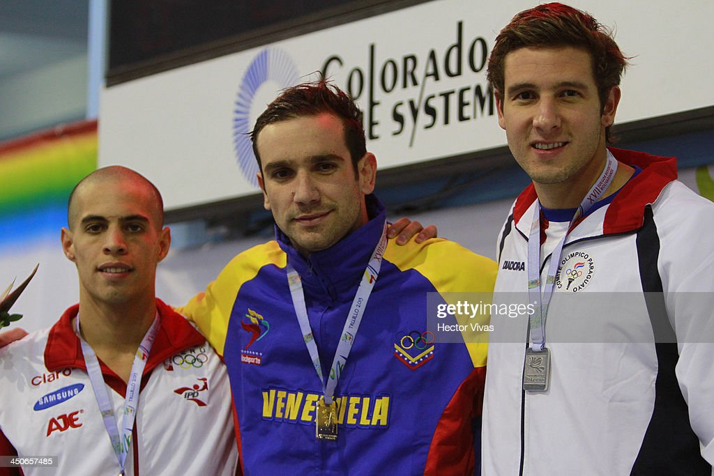 Bronce medalist Mauricio Fiol of Peru, gold medalist Albert Subirats of Venezuela and silver medalist Benjamin Hockin of Paraguay pose during the 100 meter butterfly event ceremony as part of the XVII Bolivarian Games Trujillo 2013 at pools complex of Mansiche Stadium on November 19, 2013 in Trujillo, Peru.