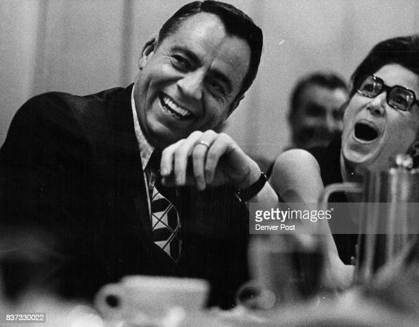 Bronco Coach John Ralston and his wife react with big laugh over humorous remarks directed at his coaching by guest speaker Howard Cosell Credit...