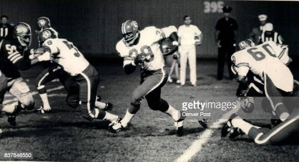 Bronco Smiley Takes a Step in the Right Direction Fullback Tom Smiley of the Denver Broncos cuts to his left and heads for open ground during...