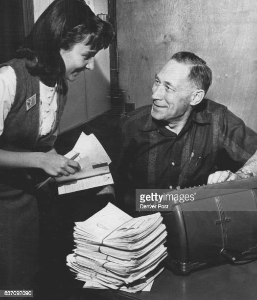 Bronco tickets sales zoom Earl Hartman Denver Bronco business manager and Joan Schneider process a stack of applications for season tickets to 1965...