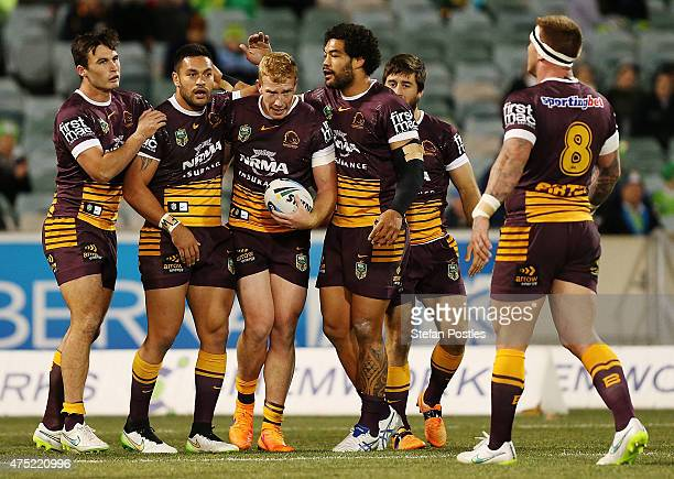 Broncos celebrate after Jack Reed of the Broncos scored a try during the round 12 NRL match between the Canberra Raiders and the Brisbane Broncos at...