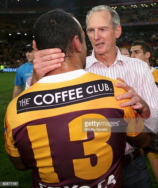 Broncos coach Wayne Bennett and Tonie Carroll of the Broncos embrace after the round 26 NRL match between the Brisbane Broncos and the Newcastle...