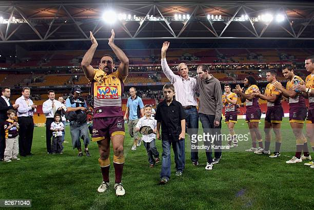 Broncos coach Wayne Bennett with son Justin and Tonie Carroll of the Broncos farewell fans after the round 26 NRL match between the Brisbane Broncos...