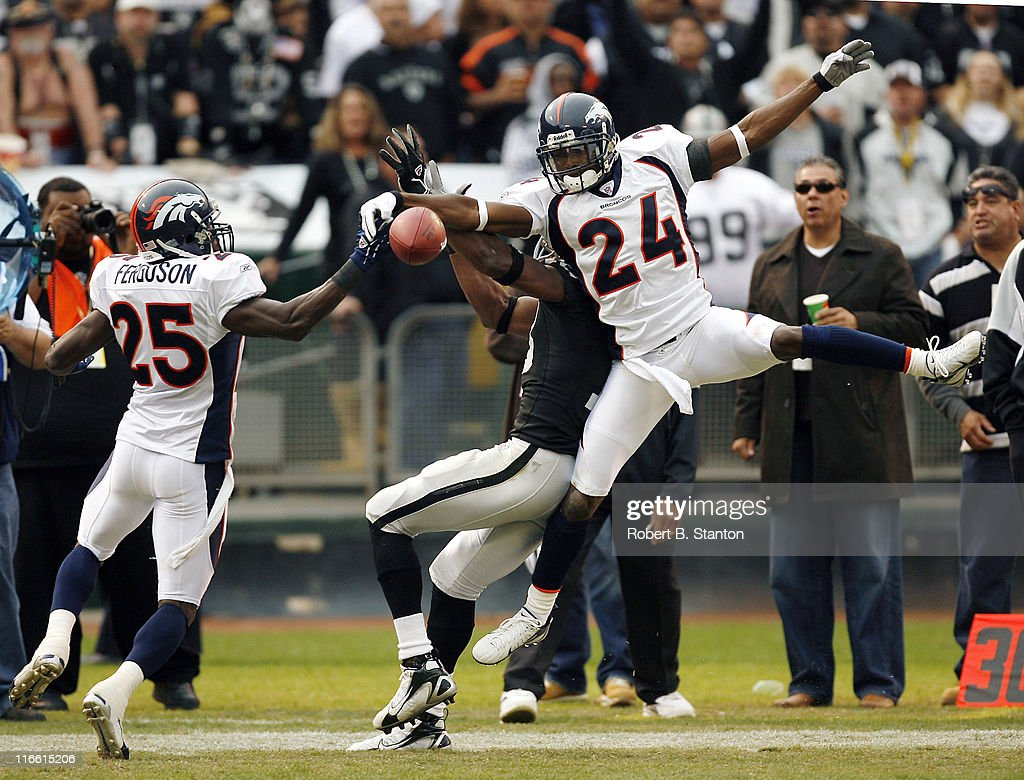 Broncos corner <a gi-track='captionPersonalityLinkClicked' href=/galleries/search?phrase=Champ+Bailey&family=editorial&specificpeople=213482 ng-click='$event.stopPropagation()'>Champ Bailey</a> and safety Nick Ferfuson break up a pass to Oakland receiver <a gi-track='captionPersonalityLinkClicked' href=/galleries/search?phrase=Randy+Moss&family=editorial&specificpeople=201999 ng-click='$event.stopPropagation()'>Randy Moss</a> as the Denver Broncos defeated the Oakland Raiders by a score of 17 to 13 at McAfee Coliseum, Oakland, California, November 12, 2006.