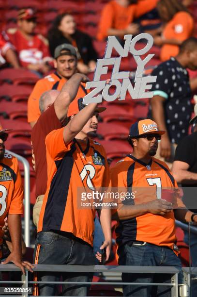 Broncos fan holds up a No Fly Zone sign during pregame warmups prior to an NFL preseason game between the Denver Broncos and the San Francisco 49ers...