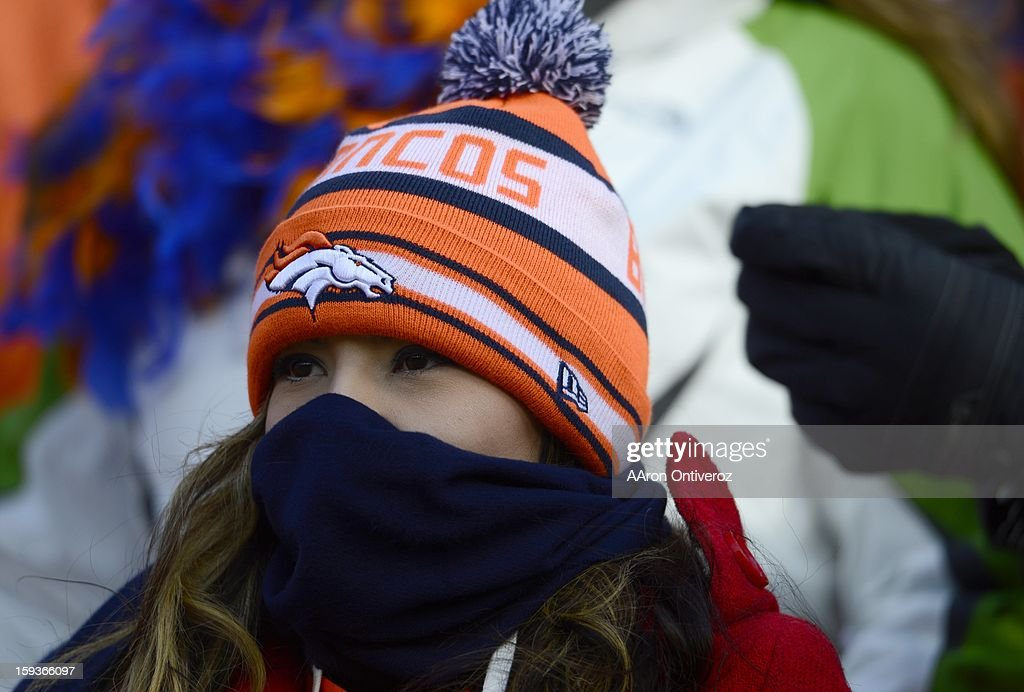 Broncos fans bundle up in the first quarter. The Denver Broncos vs Baltimore Ravens AFC Divisional playoff game at Sports Authority Field Saturday January 12, 2013.