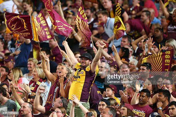 Broncos fans celebrate during the 2015 NRL Grand Final match between the Brisbane Broncos and the North Queensland Cowboys at ANZ Stadium on October...