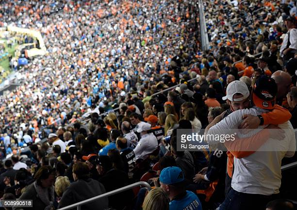 Broncos fans embrace near the end of the game The Broncos defeated the Panthers 24 to 10 in Super Bowl 50 The Denver Broncos played the Carolina...