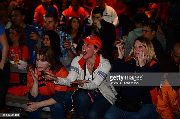 Broncos fans scream at the tv screens as a call is made against the Broncos in the third quarter of the Super Bowl while watching the game at...