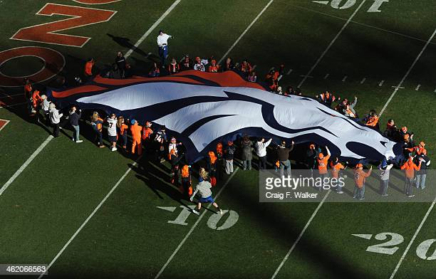 Broncos fans wave the Bronco logo before the start of the game The Denver Broncos take on the San Diego Chargers at Sports Authority Field at Mile...