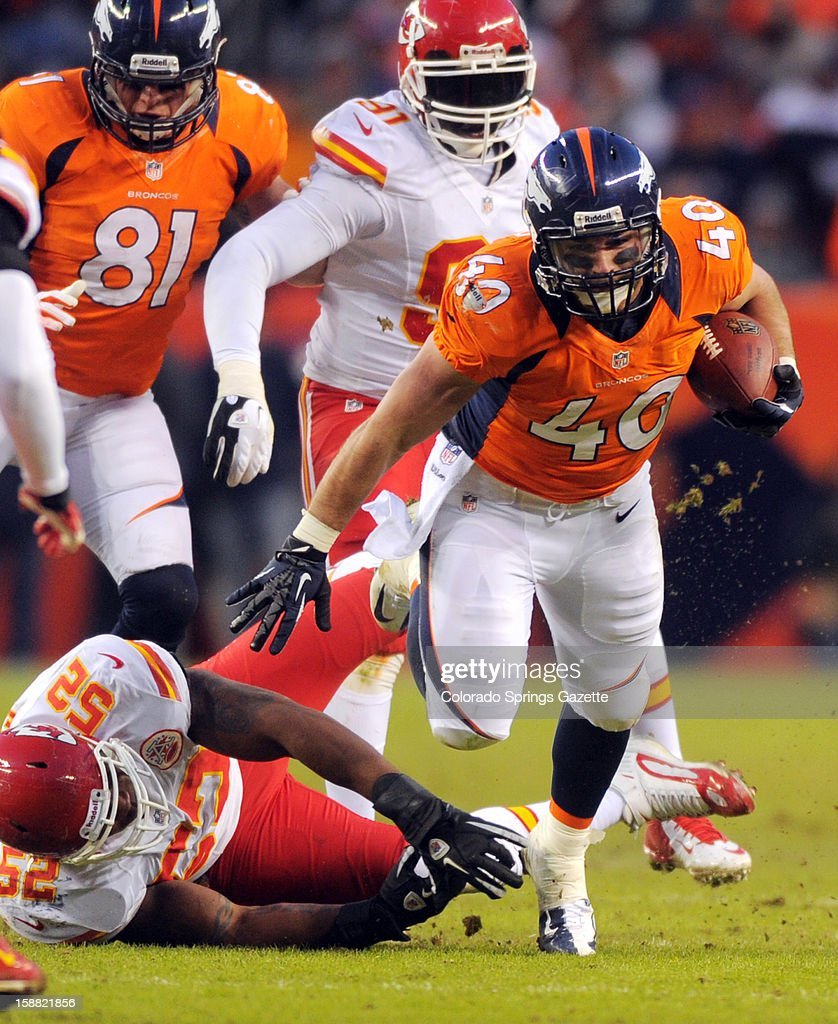 Broncos' fullback Jacob Hester breaks free of the tackle of Chiefs linebacker Brandon Siler in the fourth quarter on Sunday, December 30, 2012, at Sports Authority Field in Denver, Colorado. The Denver Broncos defeated the Kansas City Chiefs, 38-3.