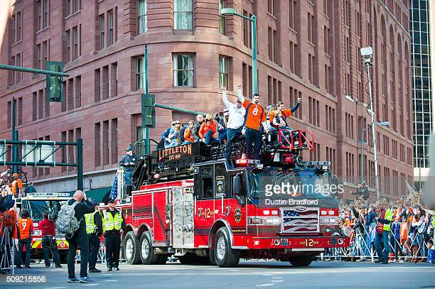 Broncos players and personnel including Brandon McManus and Britton Colquitt take part in a victory parade after the Broncos won Super Bowl 50 on...