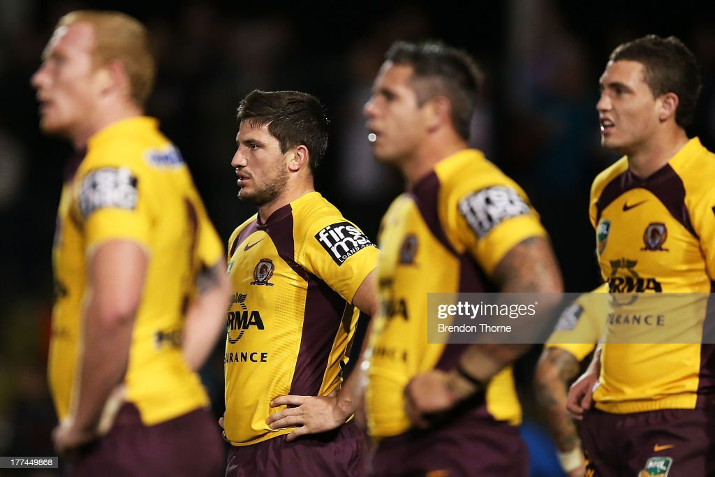 Broncos players look dejected after conceding a try during the round 24 NRL match between the Penrith Panthers and the Brisbane Broncos at Centrebet Stadium on August 23, 2013 in Sydney, Australia.