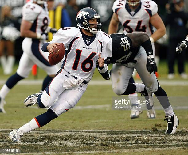 Broncos quarterback Jake Plummer rolls out in the first quarter as the Denver Broncos defeated the Oakland Raiders by a score of 17 to 13 at McAfee...