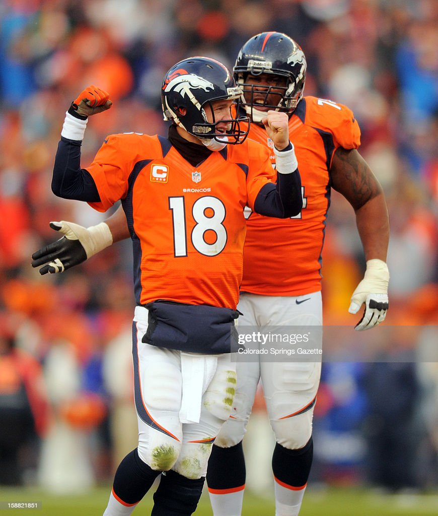 Broncos quarterback Peyton Manning and tackle Orlando Franklin celebrate Mannning's 16-yard touchdown pass to Eric Decker in the second quarter on Sunday, December 30, 2012, at Sports Authority Field in Denver, Colorado. The Denver Broncos defeated the Kansas City Chiefs, 38-3.