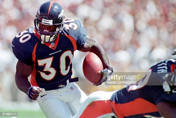 Broncos running back Terrell Davis looks for and opening in the Green Bay defense while trying to get in the inzone from the 3 yard line during an...