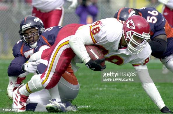 Broncos' safety Billy Jenkins and linebacker Al Wilson tackle Chiefs' tight end Tony Gonzalez after Gonzalez makes a 10yard reception during their 24...