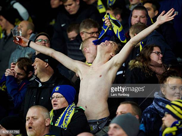 Brondby IF fan cheer during the Danish Alka Superliga match between Brondby IF and FC Midtjylland at Brondby Stadion on December 11 2016 in Brondby...