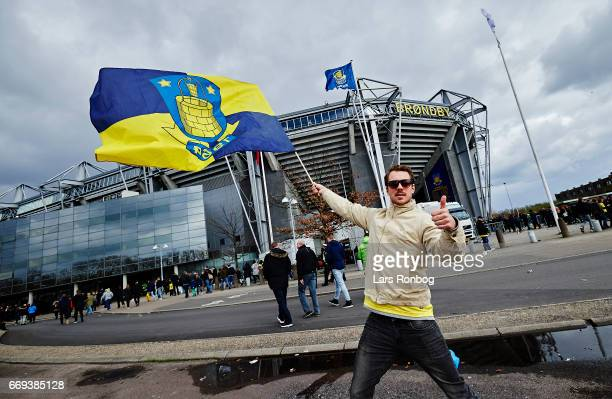 Brondby IF fan with a flag in front of the stadium prior to the Danish Alka Superliga match between Brondby IF and FC Copenhagen at Brondby Stadion...