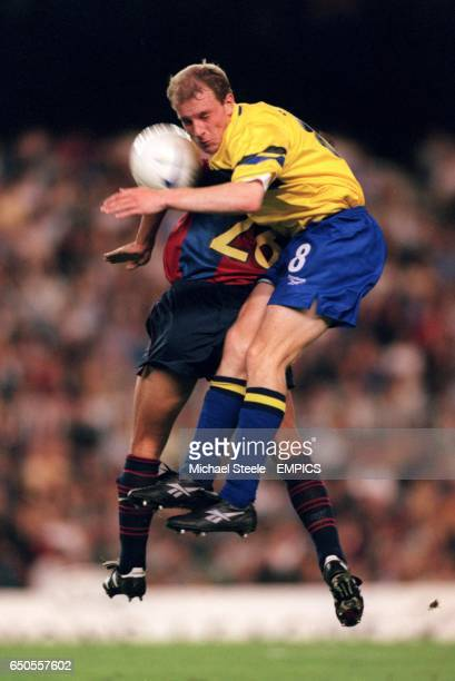 Brondby's Kim Daugaard gets above Barcelona's Xavi to win a header