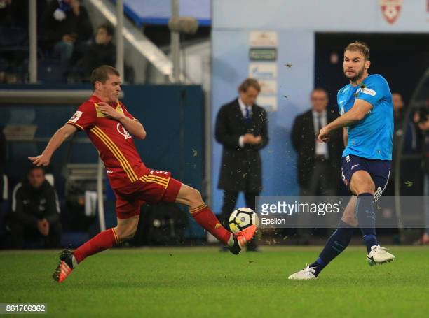 Bronislav Ivanovich of FC Zenit St Petersburg vies for the ball with Alexandru Bourceanu of FC Arsenal Tula during the during the Russian Premier...