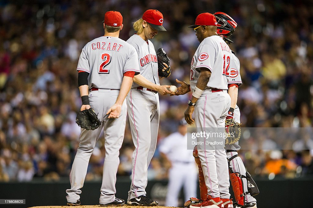Bronson Arroyo #61 is removed from the game by manager Dusty Baker #12 of the Cincinnati Reds after giving up five earned runs recording one out in the fourth inning of a game at Coors Field on August 30, 2013 in Denver, Colorado.