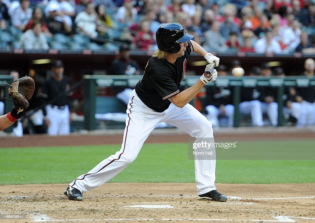<a gi-track='captionPersonalityLinkClicked' href=/galleries/search?phrase=Bronson+Arroyo&family=editorial&specificpeople=204136 ng-click='$event.stopPropagation()'>Bronson Arroyo</a> #61 of the Arizona Diamondbacks bunts the ball in the second inning against the Philadelphia Phillies at Chase Field on April 26, 2014 in Phoenix, Arizona.