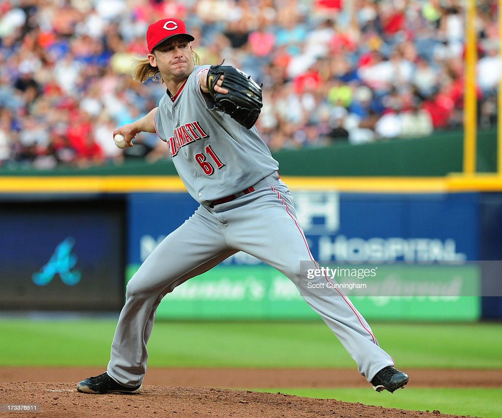 <a gi-track='captionPersonalityLinkClicked' href=/galleries/search?phrase=Bronson+Arroyo&family=editorial&specificpeople=204136 ng-click='$event.stopPropagation()'>Bronson Arroyo</a> #61 of the Cincinnati Reds pitches against the Atlanta Braves at Turner Field on July 12, 2013 in Atlanta, Georgia.