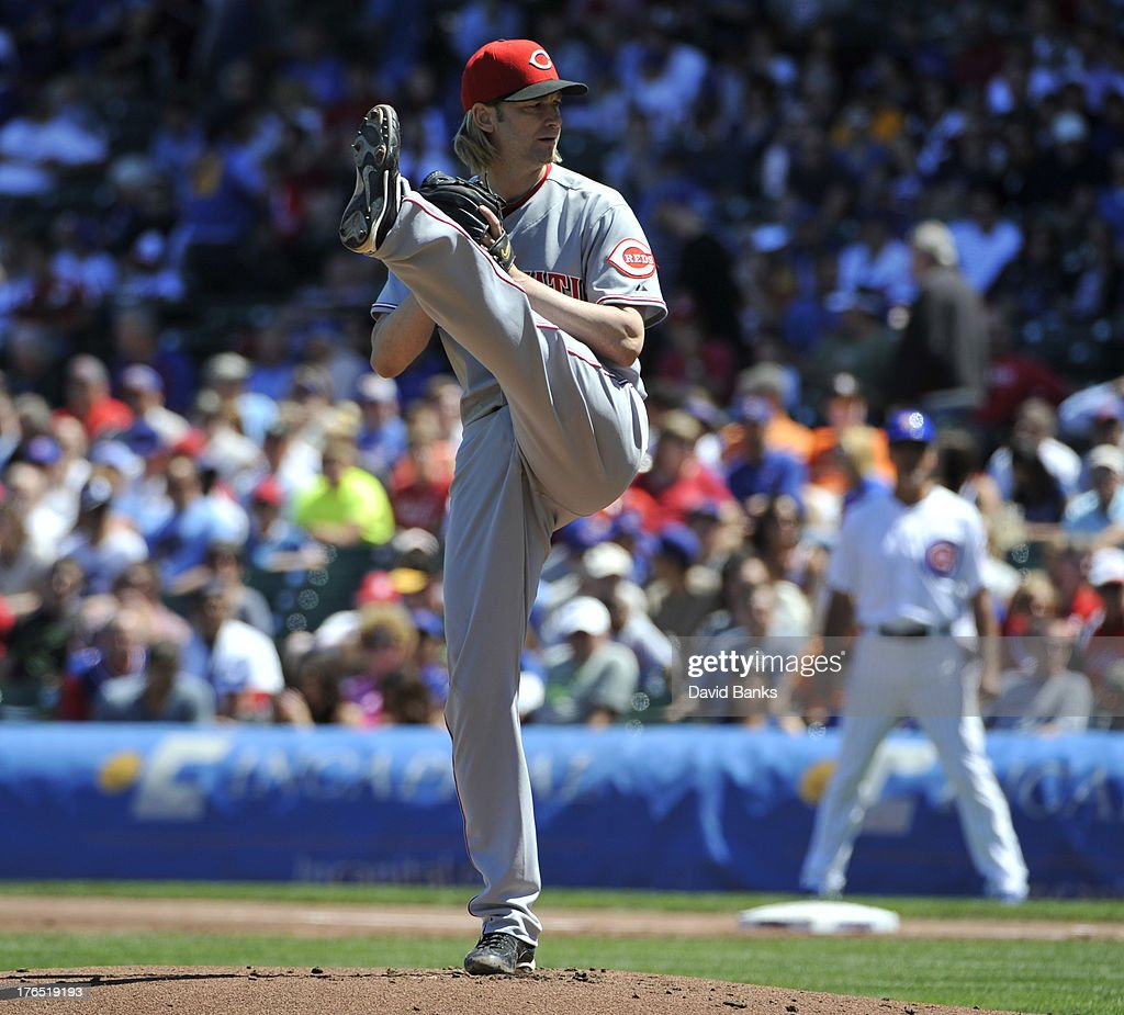<a gi-track='captionPersonalityLinkClicked' href=/galleries/search?phrase=Bronson+Arroyo&family=editorial&specificpeople=204136 ng-click='$event.stopPropagation()'>Bronson Arroyo</a> #61 of the Cincinnati Reds pitches against the Chicago Cubs during the first inning on August 14, 2013 at Wrigley Field in Chicago, Illinois.