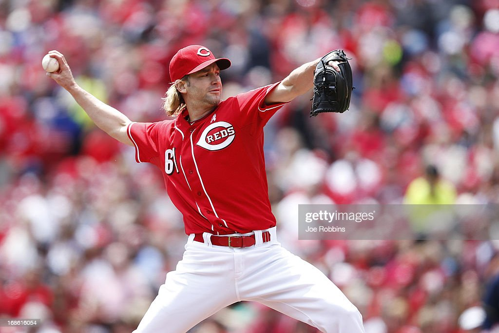 <a gi-track='captionPersonalityLinkClicked' href=/galleries/search?phrase=Bronson+Arroyo&family=editorial&specificpeople=204136 ng-click='$event.stopPropagation()'>Bronson Arroyo</a> #61 of the Cincinnati Reds pitches against the Milwaukee Brewers during the game at Great American Ball Park on May 12, 2013 in Cincinnati, Ohio.