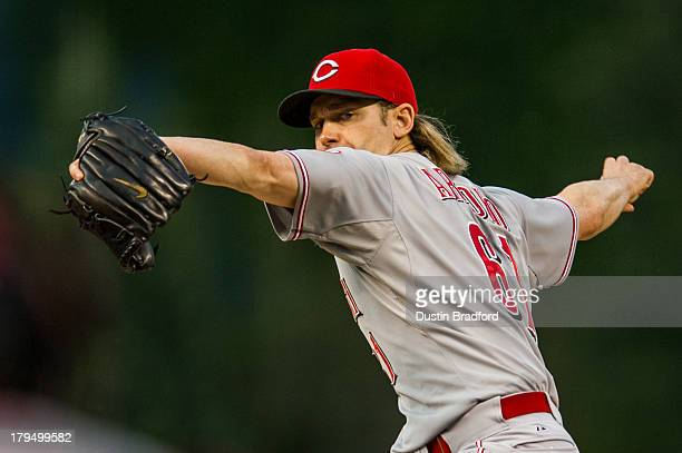 Bronson Arroyo of the Cincinnati Reds pitches from the stretch against the Colorado Rockies during the first inning of a game at Coors Field on...