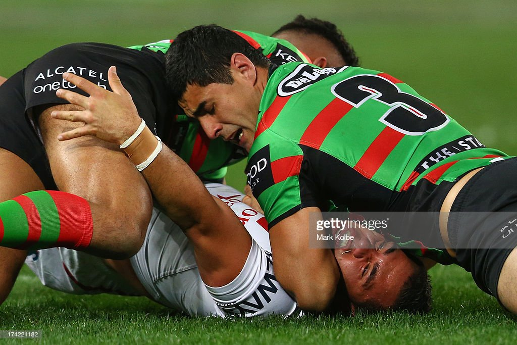 Bronson Harrison of the Dragons is tackled during the round 19 NRL match between the South Sydney Rabbitohs and the St George Illawarra Dragons at ANZ Stadium on July 22, 2013 in Sydney, Australia.