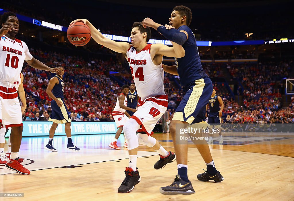 <a gi-track='captionPersonalityLinkClicked' href=/galleries/search?phrase=Bronson+Koenig&family=editorial&specificpeople=9510843 ng-click='$event.stopPropagation()'>Bronson Koenig</a> #24 of the Wisconsin Badgers battles for the ball against Cameron Johnson #23 of the Pittsburgh Panthers in the second half of their game during the first round of the 2016 NCAA Men's Basketball Tournament at Scottrade Center on March 18, 2016 in St Louis, Missouri.