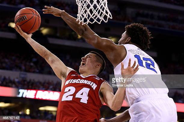 Bronson Koenig of the Wisconsin Badgers drives to the basket against Justise Winslow of the Duke Blue Devils in the second half during the NCAA Men's...