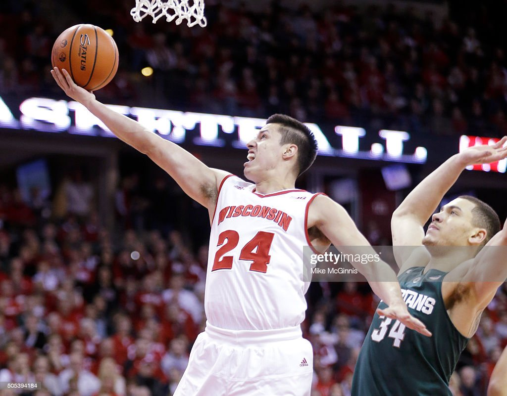 <a gi-track='captionPersonalityLinkClicked' href=/galleries/search?phrase=Bronson+Koenig&family=editorial&specificpeople=9510843 ng-click='$event.stopPropagation()'>Bronson Koenig</a> #24 of the Wisconsin Badgers drives to the hoop for two points during there first half against the Michigan State Spartans at Kohl Center on January 17, 2016 in Madison, Wisconsin.