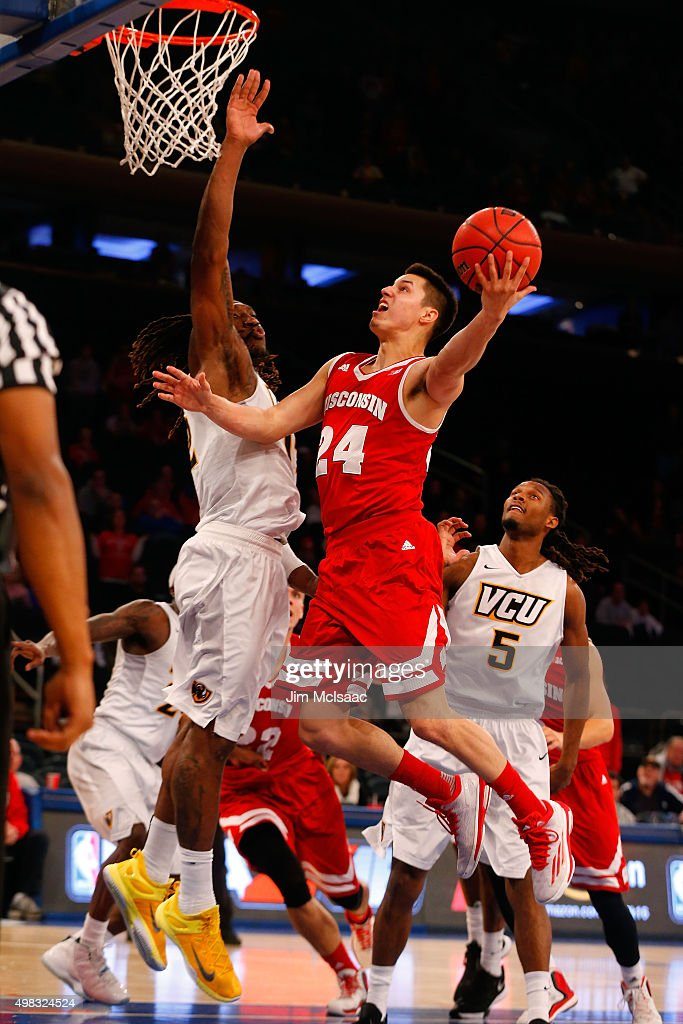 <a gi-track='captionPersonalityLinkClicked' href=/galleries/search?phrase=Bronson+Koenig&family=editorial&specificpeople=9510843 ng-click='$event.stopPropagation()'>Bronson Koenig</a> #24 of the Wisconsin Badgers goes to the hoop for the game winning basket in the final seconds of the 2K Classic consolation game against Mo Alie-Cox #12 of the Virginia Commonwealth Rams at Madison Square Garden on November 22, 2015 in New York City.