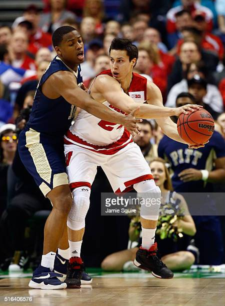 Bronson Koenig of the Wisconsin Badgers handles the ball against Chris Jones of the Pittsburgh Panthers in the first half of their game during the...