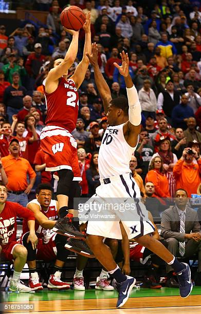 Bronsosn Koenig of the Wisconsin Badgers shoots and makes the game winning basket against Remy Abell of the Xavier Musketeers during the second round...