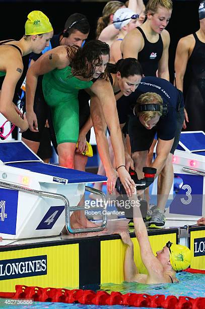 Bronte Barratt of Australia is congratulated by team mates Emma McKeon Alicia Coutts and Brittany Elmslie of Australia after winning the gold medal...