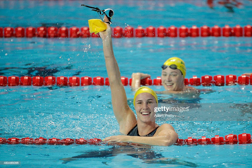 Bronte Campbell of Australia celebrates winning the gold medal in the Women's 50m Freestyle Final as Cate Campbell of Australia looks on during day...