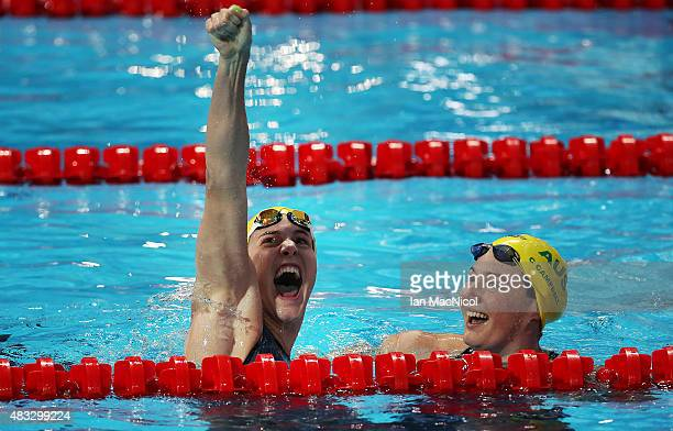 Bronte Campbell of Australia celebrates winning the Women's 100m Freestyle as her sister Cate looks on during day fourteen of The 16th FINA World...