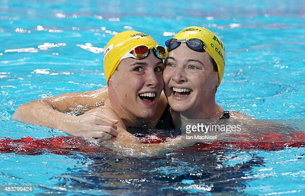 Bronte Campbell of Australia celebrates winning the Women's 100m Freestyle with her sister Cate Campbell during day fourteen of The 16th FINA World...