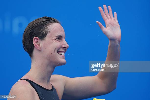 Bronte Campbell of Australia waves after swimming the Women's 100m Freestyle heats during day two of the 2014 Pan Pacific Championships at Gold Coast...