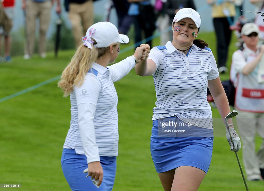Bronte Law of England and the Great Britain and Ireland team congratulates her partner Olivia Mehaffey of Northern Ireland after Mehaffey's second...