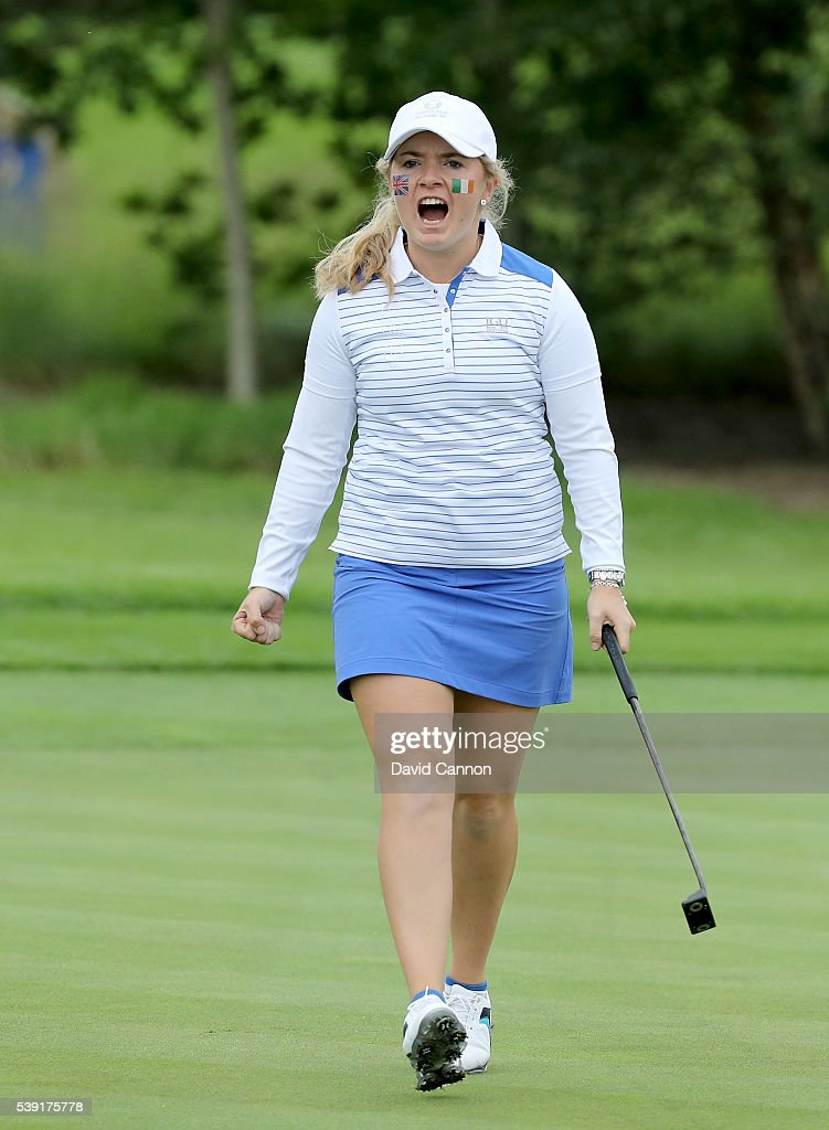 Bronte Law of England and the Great Britain and Ireland team celebrates holing her match winning birdie putt on the 17th hole in her match with...