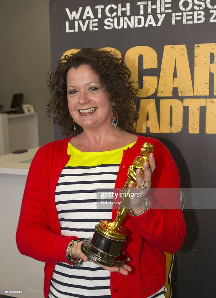 Bronwyn Swartz of Austin, holds the Oscar statue during the First-Ever Oscar Roadtrip on February 17, 2013 in Houston, Texas.