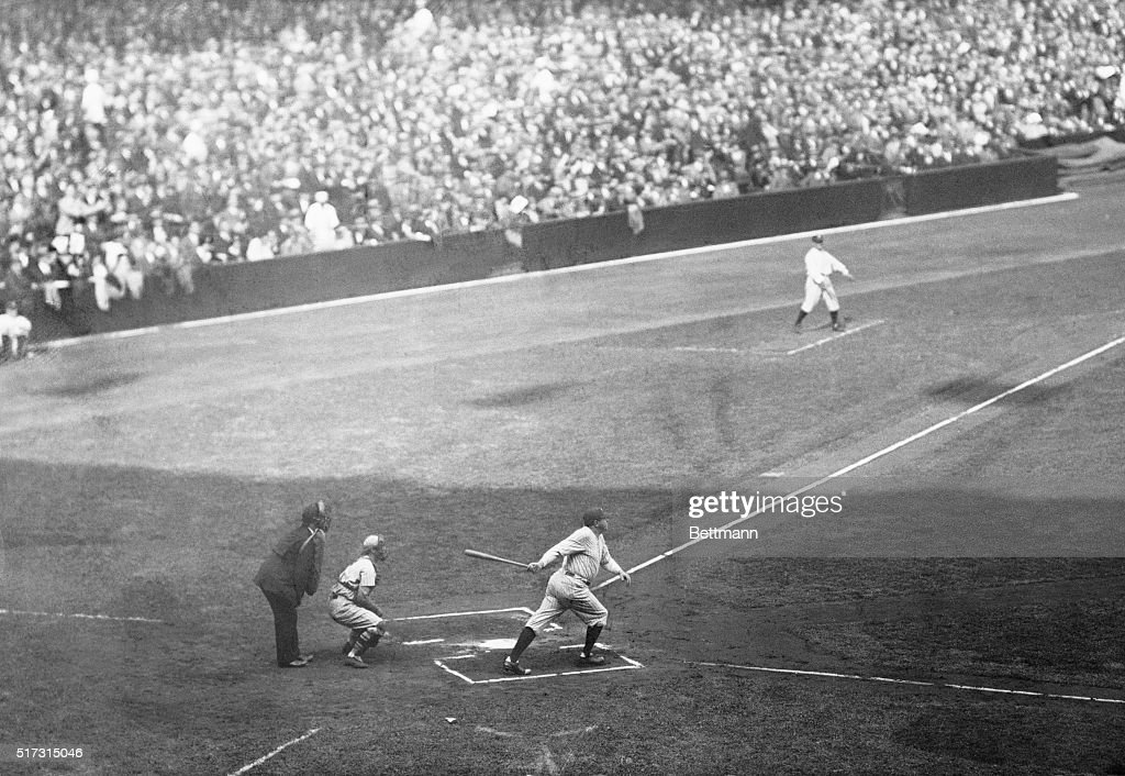Babe Ruth hitting a double in the first inning of the first game of the World Series today Ruth scored later when Gehrig doubled