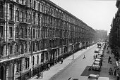 High angle view of a row of apartment buildings along a street in the Bronx New York New York 1950s