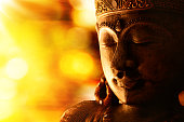 oriental culture -  golden Buddha with blurred light