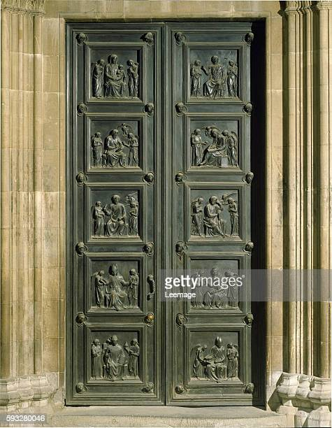 Bronze door decorated with bas reliefs of the Resurrection and Ascension of Christ by Luca della Robbia Cathedral of Santa Maria del Fiore Florence...